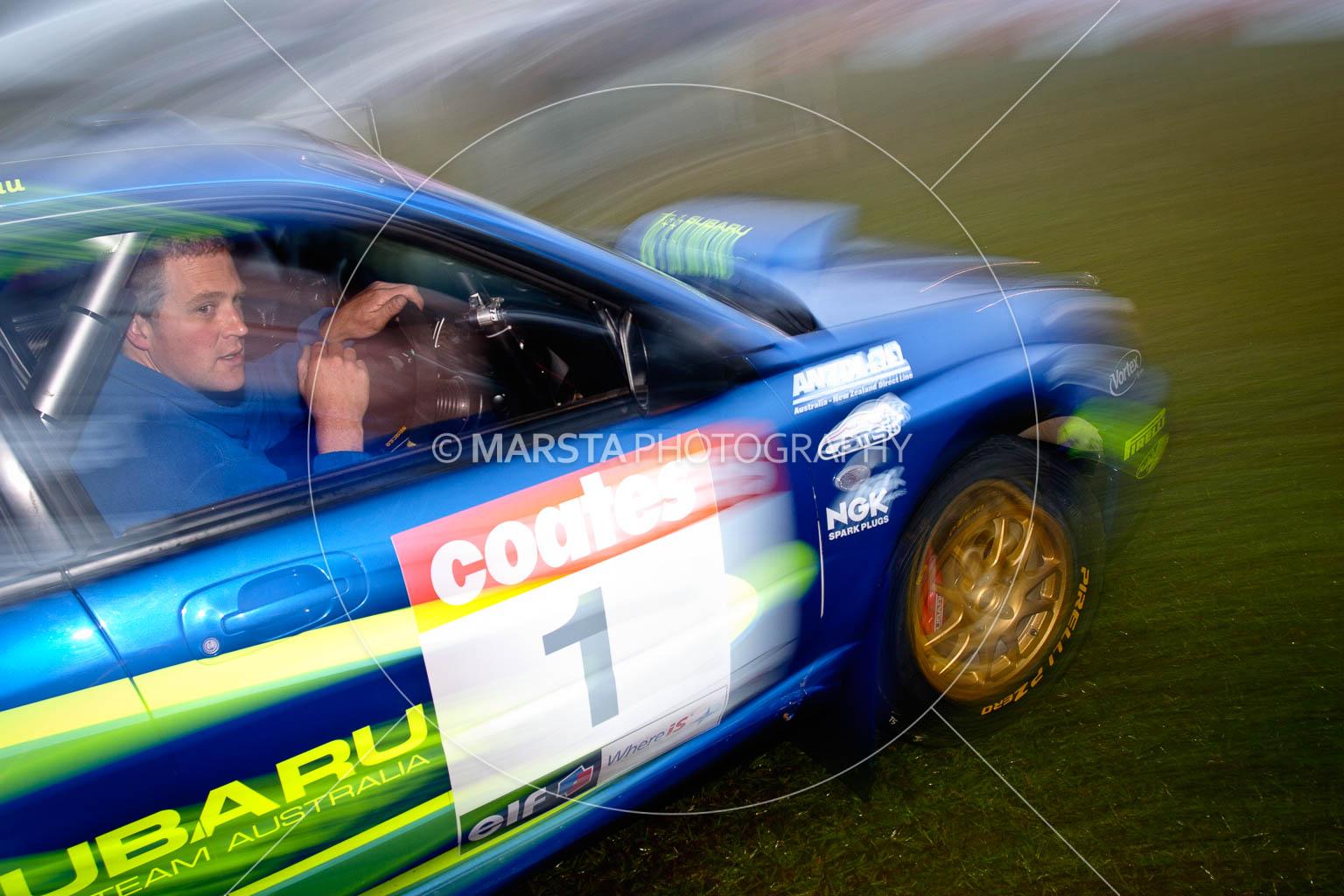 (1);4 June 2005;ARC;Australia;Australian Rally Championship;Coates Rally Queensland;Imbil;QLD;Queensland;Subaru Impreza WRX;Sunshine Coast;Topshot;auto;morning;motion blur;motorsport;movement;racing;service park;wide angle