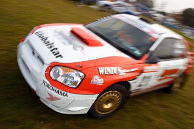 21;050605ARC;4-June-2005;ARC;Australia;Australian-Rally-Championship;Coates-Rally-Queensland;Darren-Windus;Imbil;Jonathan-Mortimor;QLD;Queensland;Subaru-Impreza-WRX;Sunshine-Coast;auto;motion-blur;motorsport;movement;racing;service-park;wide-angle