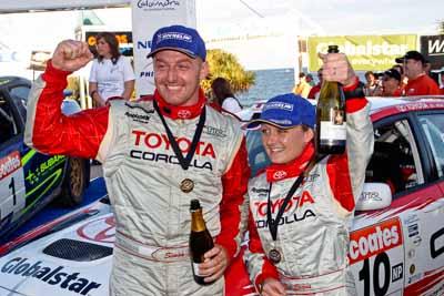 050605ARC;5-June-2005;ARC;Australia;Australian-Rally-Championship;Caloundra;Coates-Rally-Queensland;QLD;Queensland;Simon-Evans;Sue-Evans;Sunshine-Coast;afternoon;auto;motorsport;official-finish;podium;portrait;racing