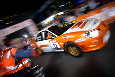 12;16-June-2006;ARC;Australia;Australian-Rally-Championship;Darren-Windus;Jonathon-Mortimer;Mooloolaba;QLD;Queensland;Subaru-Impreza-WRX;Sunshine-Coast;Topshot;atmosphere;auto;ceremonial-start;motorsport;movement;night;orange;racing;speed;wide-angle