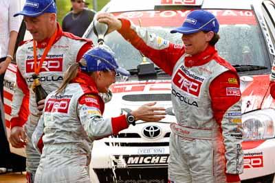 18-June-2006;ARC;Australia;Australian-Rally-Championship;Coral-Taylor;Mooloolaba;QLD;Queensland;Simon-Evans;Sue-Evans;Sunshine-Coast;atmosphere;auto;ceremonial-finish;motorsport;podium;racing;telephoto