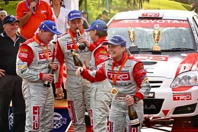 18-June-2006;ARC;Australia;Australian-Rally-Championship;Coral-Taylor;Mooloolaba;Neal-Bates;QLD;Queensland;Simon-Evans;Sue-Evans;Sunshine-Coast;Topshot;atmosphere;auto;ceremonial-finish;motorsport;podium;racing;telephoto