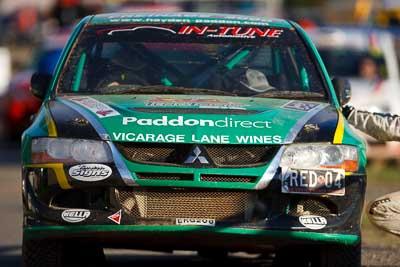 4;10-May-2009;APRC;Asia-Pacific-Rally-Championship;Australia;Evo-9;Hayden-Paddon;IROQ;Imbil;Imbil-Showgrounds;International-Rally-Of-Queensland;John-Kennard;Mitsubishi-Lancer;Mitsubishi-Lancer-Evolution-IX;QLD;Queensland;Rally-Queensland;Sunshine-Coast;Team-Green-NZ;auto;celebration;in‒car;motorsport;official-finish;podium;racing;showgrounds;super-telephoto