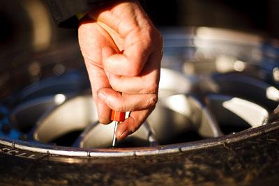 50mm;8-August-2009;Australia;Morgan-Park-Raceway;QLD;Queensland;Shannons-Nationals;Warwick;atmosphere;auto;close‒up;detail;hand;mechanic;motorsport;paddock;racing;tyre;wheel