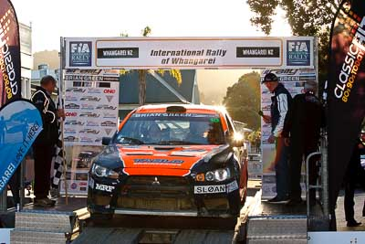 10;10;17-July-2011;APRC;Asia-Pacific-Rally-Championship;International-Rally-Of-Whangarei;Mitsubishi-Lancer-Evolution-X;NZ;New-Zealand;Northland;Rally;Sloan-Cox;Tarryn-Cox;Whangarei;auto;garage;motorsport;podium;racing;telephoto