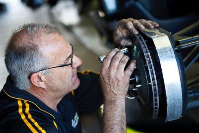 22-September-2012;Australia;Formula-3;Open-Wheeler;Phillip-Island;Shannons-Nationals;Topshot;VIC;Victoria;atmosphere;auto;brakes;inspection;mechanic;motorsport;paddock;pitlane;portrait;racing;telephoto