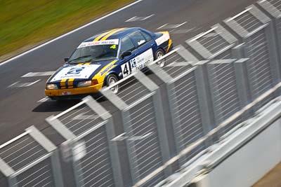 4;23-September-2012;4;Australia;Ford-Falcon-EA;Phillip-Island;Saloon-Cars;Shannons-Nationals;Tony-Auddino;VIC;Victoria;auto;fence;motion-blur;motorsport;racing;telephoto