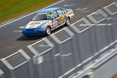 66;23-September-2012;Aarron-Paterson;Australia;Holden-Commodore-VN;Phillip-Island;Saloon-Cars;Shannons-Nationals;VIC;Victoria;auto;fence;motion-blur;motorsport;racing;telephoto
