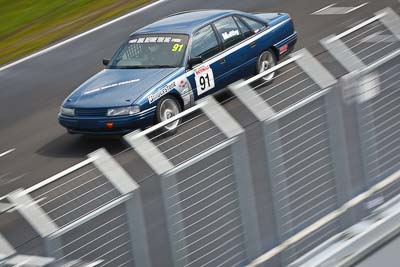 91;23-September-2012;Australia;Holden-Commodore-VN;Naomi-Maltby;Phillip-Island;Saloon-Cars;Shannons-Nationals;VIC;Victoria;auto;fence;motion-blur;motorsport;racing;telephoto