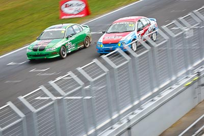 38;42;23-September-2012;38;Australia;Ford-Falcon-AU;Gavin-Ross;Holden-Commodore-VT;John-McCorkindale;Phillip-Island;Saloon-Cars;Shannons-Nationals;VIC;Victoria;auto;fence;motion-blur;motorsport;racing;telephoto