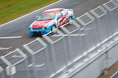 41;23-September-2012;Australia;Dennie-Rumble;Ford-Falcon-AU;Phillip-Island;Saloon-Cars;Shannons-Nationals;VIC;Victoria;auto;fence;motion-blur;motorsport;racing;telephoto