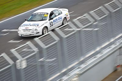 52;23-September-2012;52;Australia;Ford-Falcon-AU;Phillip-Island;Rick-Gill;Saloon-Cars;Shannons-Nationals;VIC;Victoria;auto;fence;motion-blur;motorsport;racing;telephoto