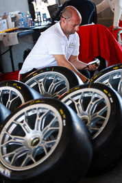 8-February-2013;Australia;Bathurst;Bathurst-12-Hour;Grand-Tourer;Mt-Panorama;NSW;New-South-Wales;atmosphere;auto;endurance;mechanic;motorsport;paddock;portrait;racing;telephoto;tyres;wheels